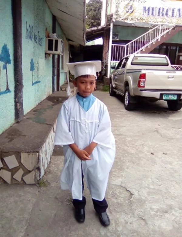 This child graduated grade school after being half-paralyzed due to a terrible accident
