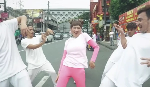 Ai-ai Delas Alas dances on the street with a crew