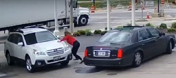 Woman stops car thief from driving away with her vehicle. She jumped on the hood unwilling to let go of her car...