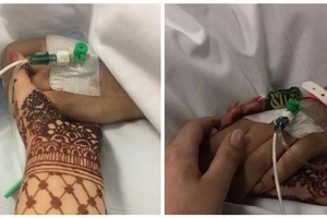 Heartbreaking Picture Shows Sister Holding Dying Brother's Hand As She Switches Off Life Support Machine