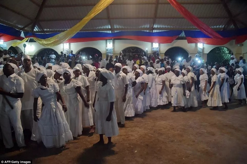 Possessed worshippers sacrifice animals and dance in sacred water during EASTER weekend (photos)