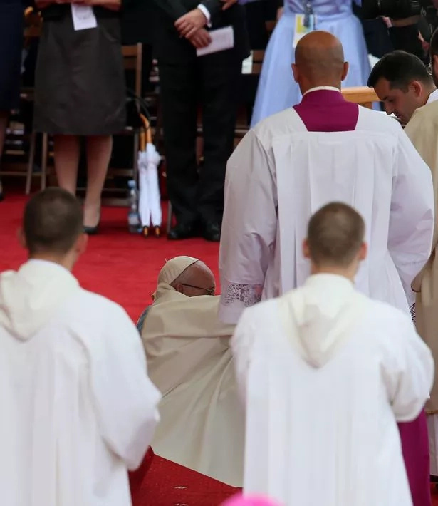 Pope Francis trips and falls during mass in Poland