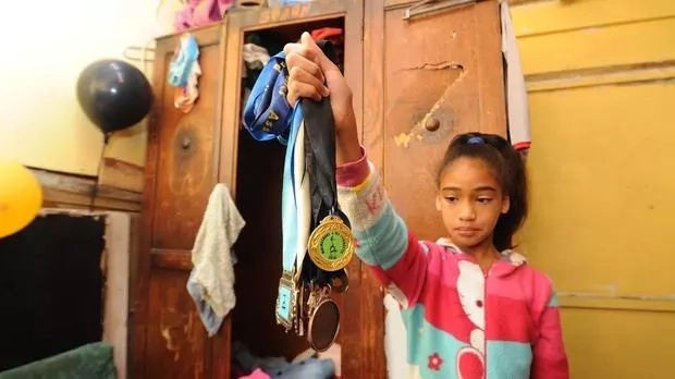 Azaliah displays some of her medals. Photo: Henk Kruger/ANA Pictures