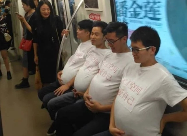 Are these men pregnant? No, they just support their wives!