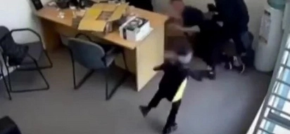 This Little Girl Is Trying To Stop An Axe-Weilding Robber From Harming A Man!