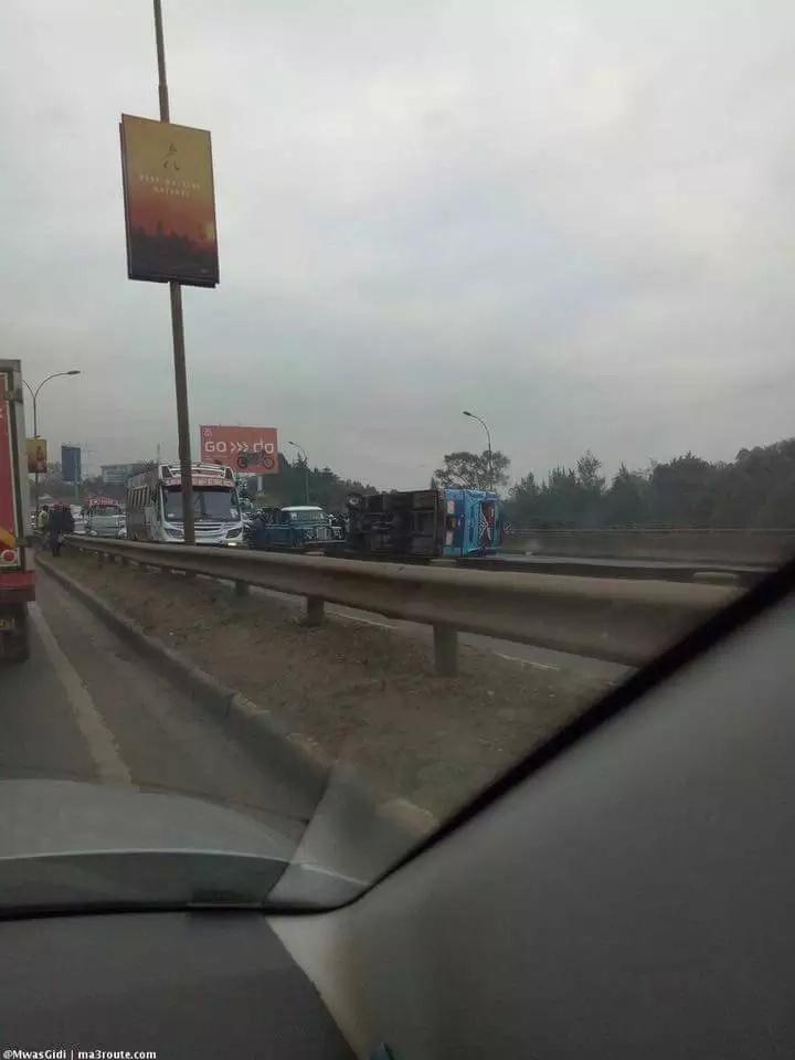 Horrible scene on Thika Road as Kenya Mpya bus overturns near Utalii Hotel (photos)