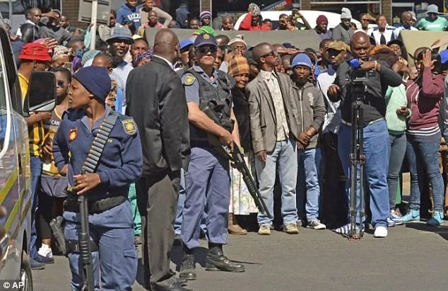 Local residents pictured outside the magistrate's court in Estcourt. Photo: AP