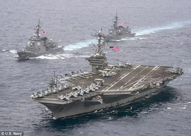 One of the two aircraft carriers, the USS Carl Vinson, sending a clear signal to North Korea