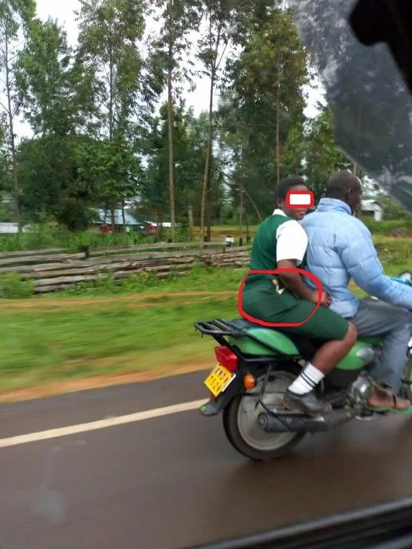 Photo of school-girl carrying alcohol on a motorbike takes social media by storm