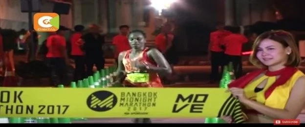 Esther Macharia about to cross the finish line