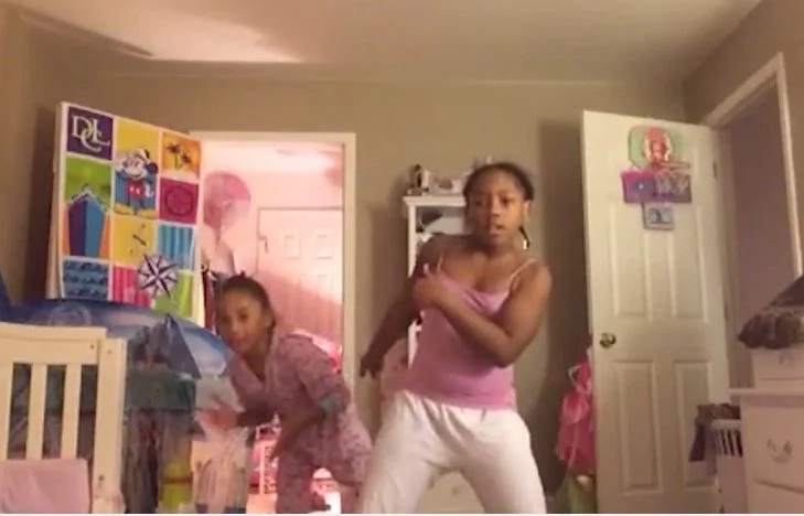 Sisters' adorable dance goes totally wrong when one of them is dropped to the ground (photos, video)