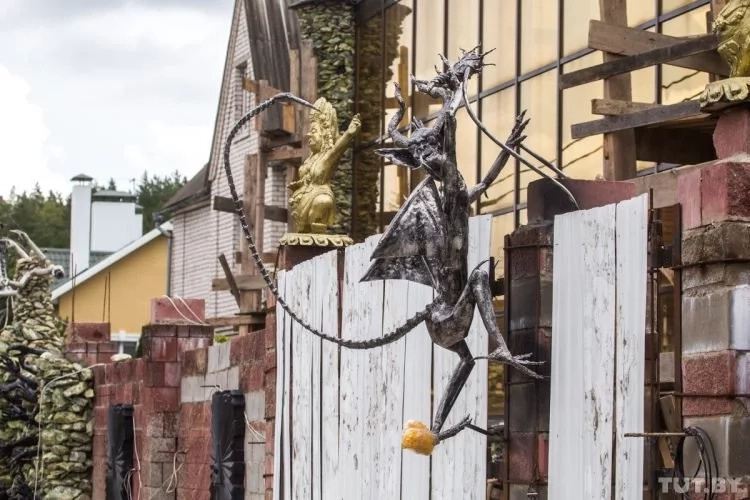 World's scariest house? It is complete with skeletal hands coming out of the fence, devils decorating the roof