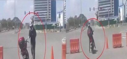 My heart stopped while watching this! Pinoy rider gets off of motorbike to show powerful dance moves in the middle of the traffic