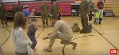 A boy with cerebral palsy walks to his Marine dad for the first time after not seeing him in over a year!
