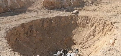 Biggest mass grave in Iraq! ISIS jihadis turn sinkhole into grave for 4000 bodies! (photos)