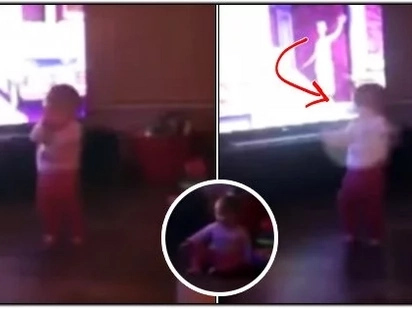 A little girl was standing in her family room, playing peek-a-boo with parents. Suddenly, some mysterious force attacked her & she lost her balance..