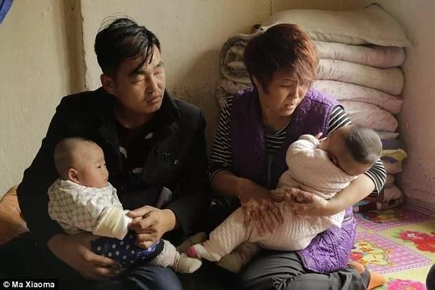 Wang Guojun (left) and Xu Shijia with their sons Wen Yuan and Wen Bo