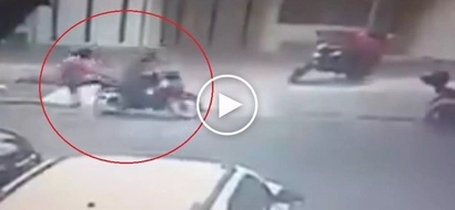 Heroic man throws awesome flying kick to rescue woman from dangerous kidnapper