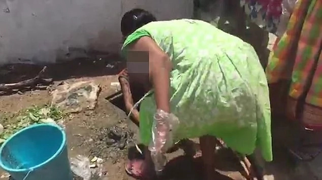 Outrage as the HIV-positive girl is cleaning sewer with bare hands