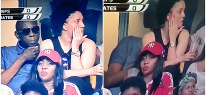 Busted! Man attending football match with 'side chick' hides when TV camera focuses on him