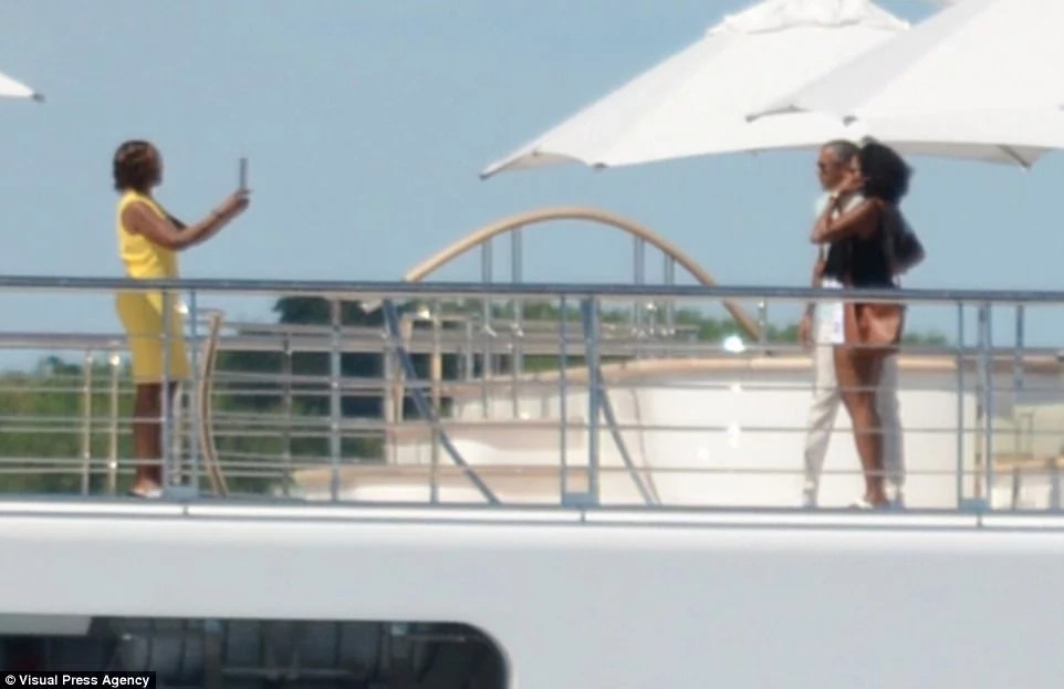 Barack and Michelle Obama seen on holiday with celebrities on Ksh30 billion super yacht (photos)