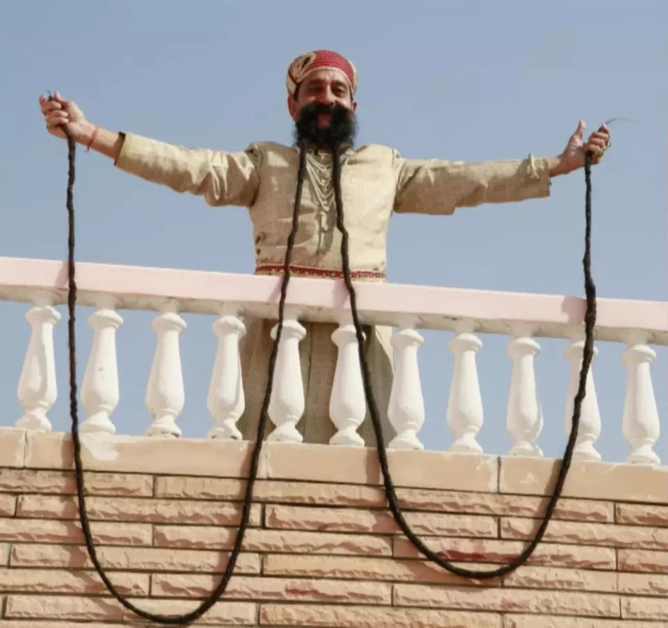 Ram Singh hold the Guinness World Record for the longest moustache. Photo: Barcroft TV