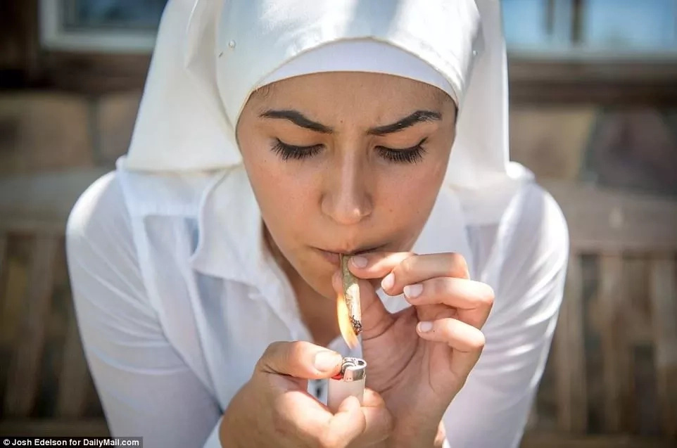 A sister pictured lighting up a joint. Photo: Daily Mail/Josh Edelson