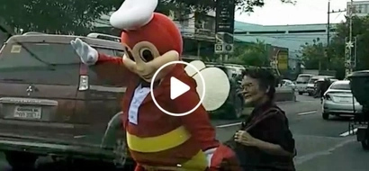 Jollibee turns into a good samaritan by helping an elderly lady cross the street