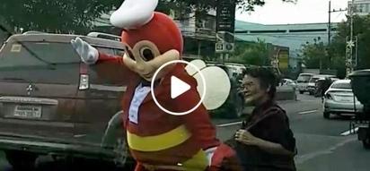 Jollibee turns into a good samaritan by helping an elderly lady cross the street