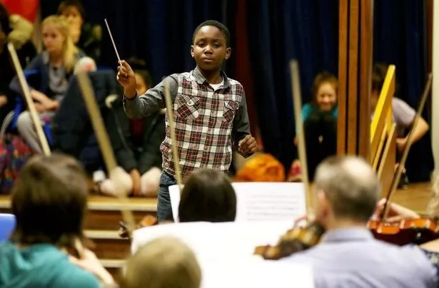 Child prodigy, 11, set to break world record of YOUNGEST orchestra conductor (photos, video)