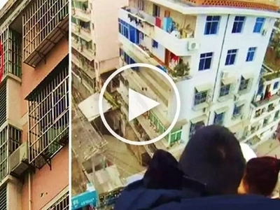 Husband rescues suicidal wife from jumping off building by grabbing her ponytail