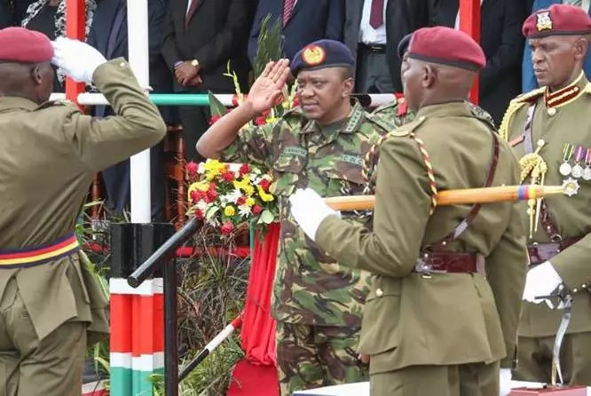 Uhuru and ex-Kenyan presidents in military uniforms