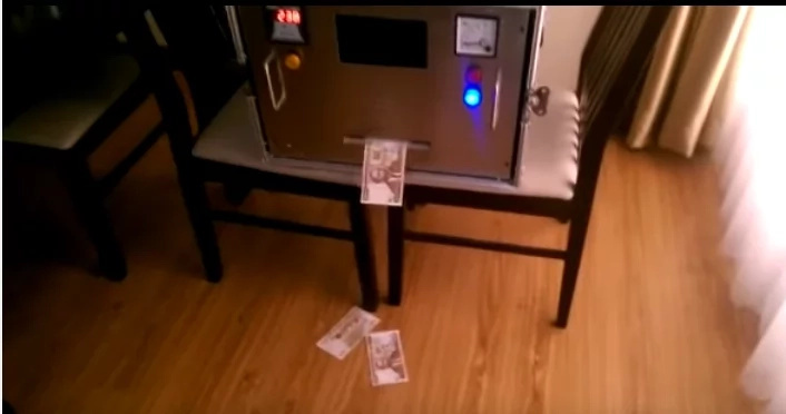 Viral video of a machine printing money at a private residence