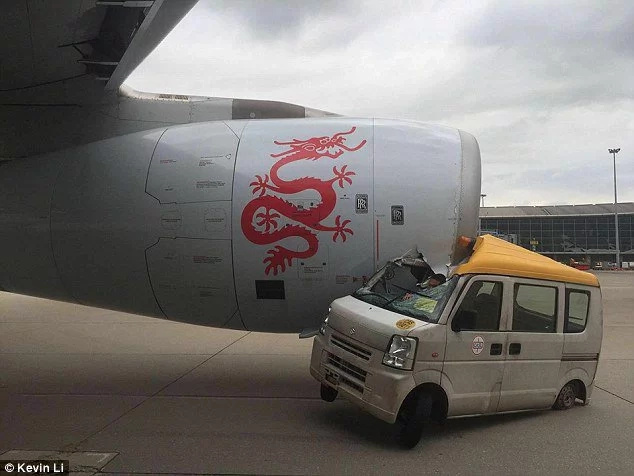 Insanely shocking moment plane's engine rips through a little van in China
