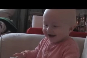 This baby, laughing hysterically at ripping paper, will make your day!