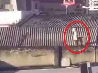 A TV thief trying to escape by rooftops got a taste of instant karma