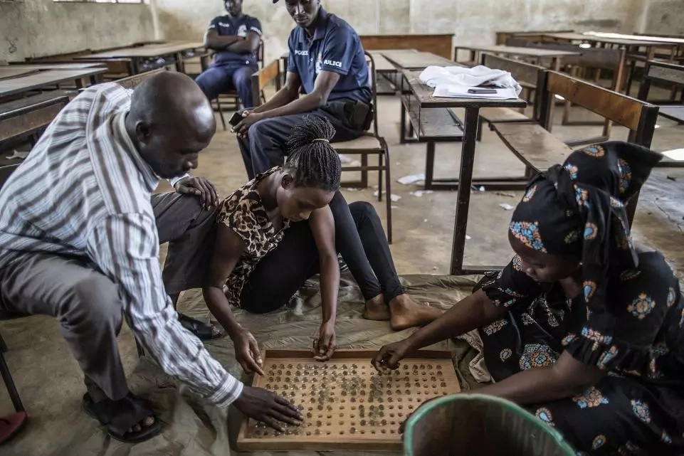 Gambians use GLASS MARBLES instead of ballot papers to vote for their MPs (see photos)