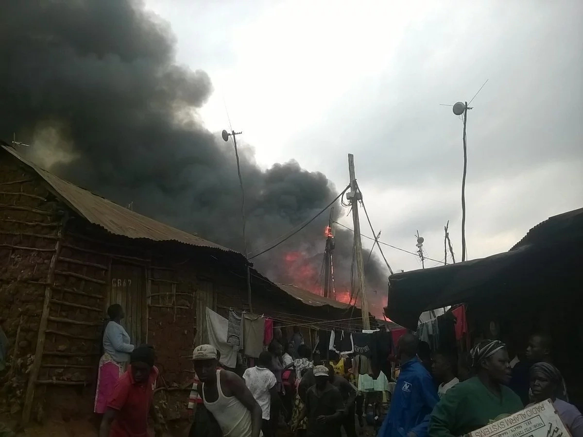 Families in Kibera cry after a fire destroys homes