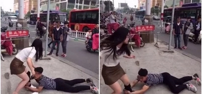 WATCH: Man crawls on the street begging pretty girl not to dump him; her reaction will amuse you!