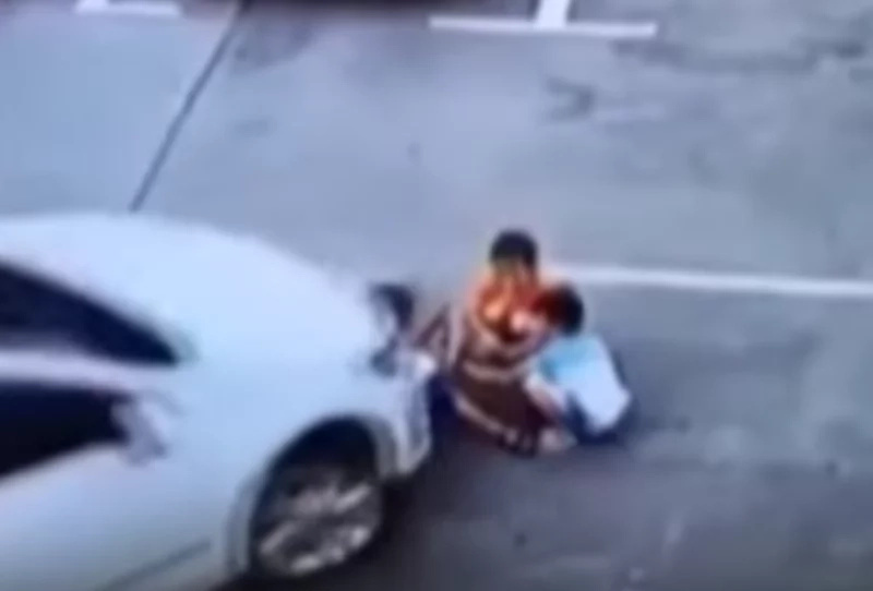 Man drives over children because he was distracted by his phone