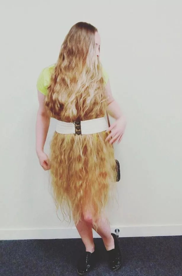 Woman, 32, who stopped cutting her hair, wears it as dress because of its astonishing length