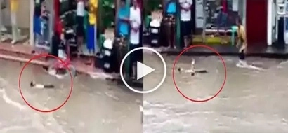 Ang benta nung bata! Kid plays dead while being carried by flood water in Manila
