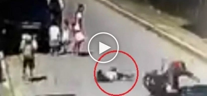 Careless Pinoy child gets brutally ran over by motorcycle while crossing street in Cavite