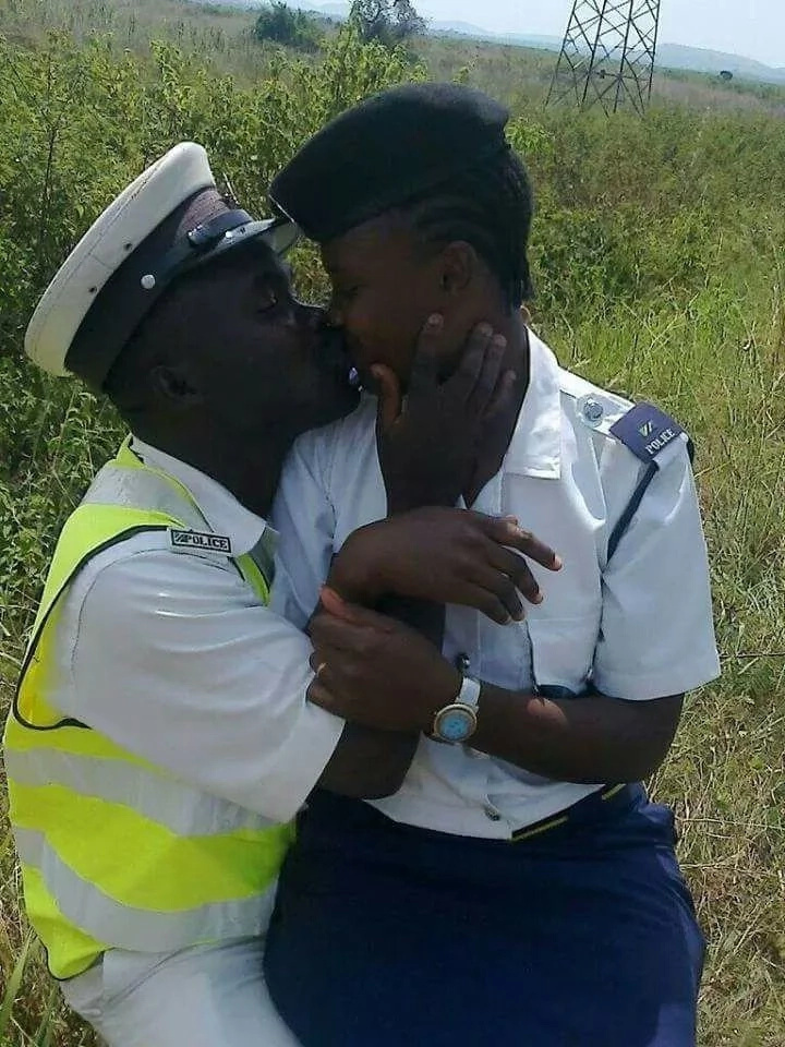 A photo of police officers kissing in he bush lights up the internet
