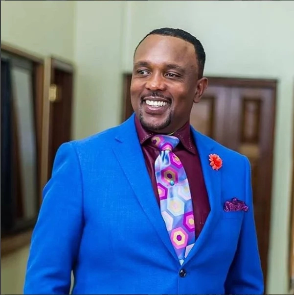 Bishop Allan Kiuna rocks his suit game, fashion style