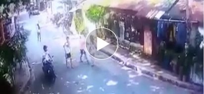 Riding in tandem! Cyclists caught on camera robbing helpless woman on street
