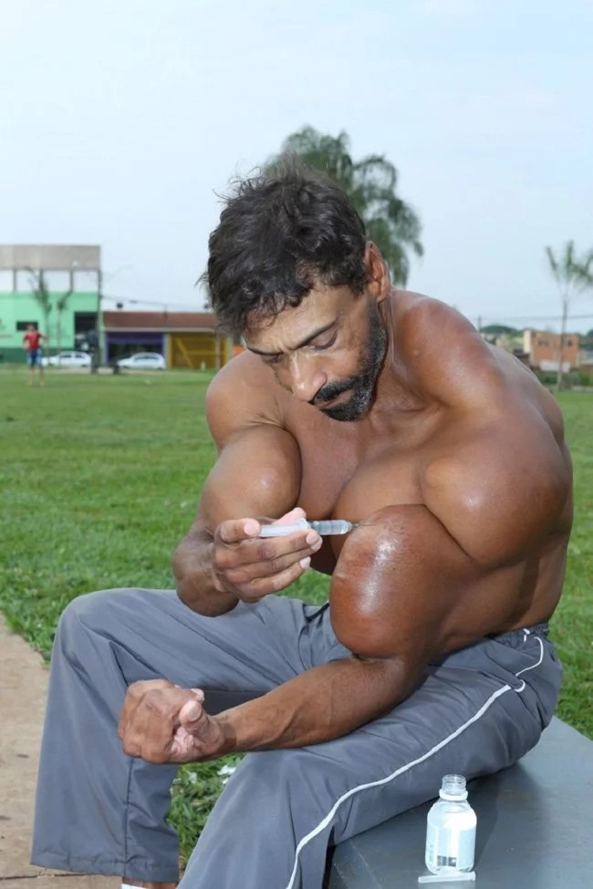 This super brawny man injects oil into his body. You won't believe the reason