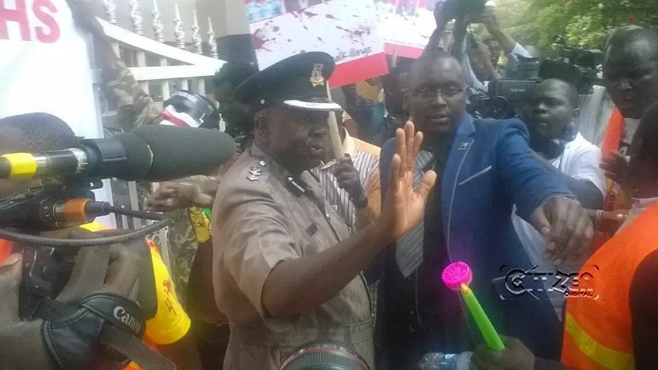 Protestors pour red paint on police spokesperson Charles Owino