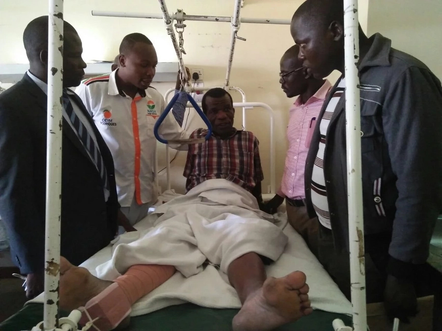 ODM diehard run over by a car during protest struggling with a broken hip in hospital (photos)