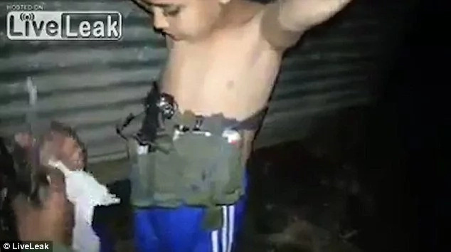 Soldiers disarm boy, 7, who had explosives strapped to his chest (photos, video)